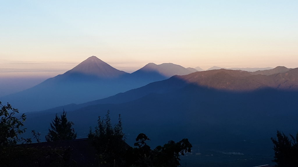 Sunrise on the Guatemalan volcanoes, Volcán Atitlan and Volcán Toliman