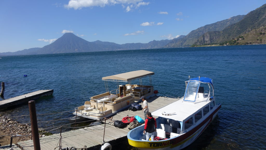 Loading the boats at Lake Atitlan - distant Volcán San Pedro, one of the Guatemalan volcanoes we would climb later in the trip