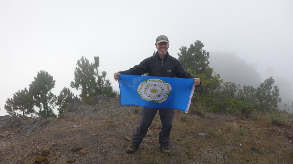 The author and Yorkshire flag on summit of Pico Zunil