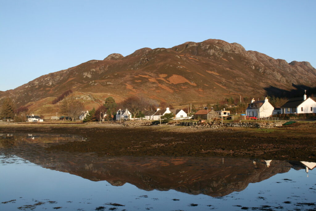 Beinn Mheadhoin reflected in Loch Long - summit is the left hand bump