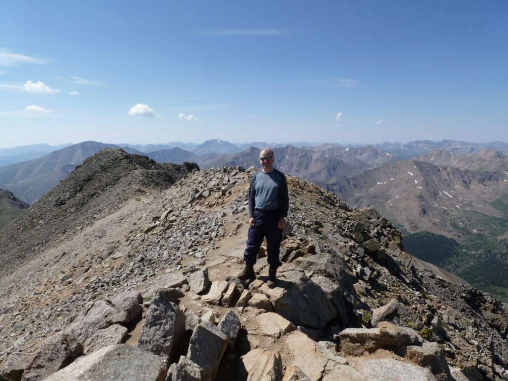 The writer on the summit of Mount Massive
