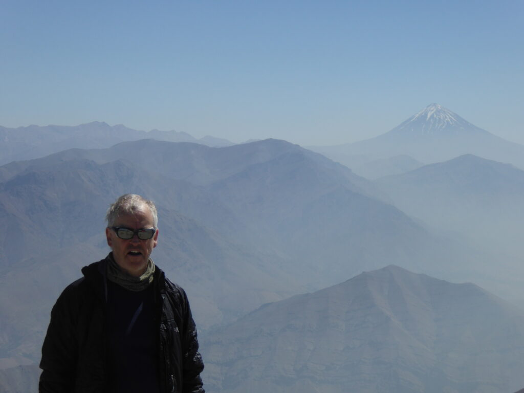 On Mount Tochal's summit with Damavand in the background